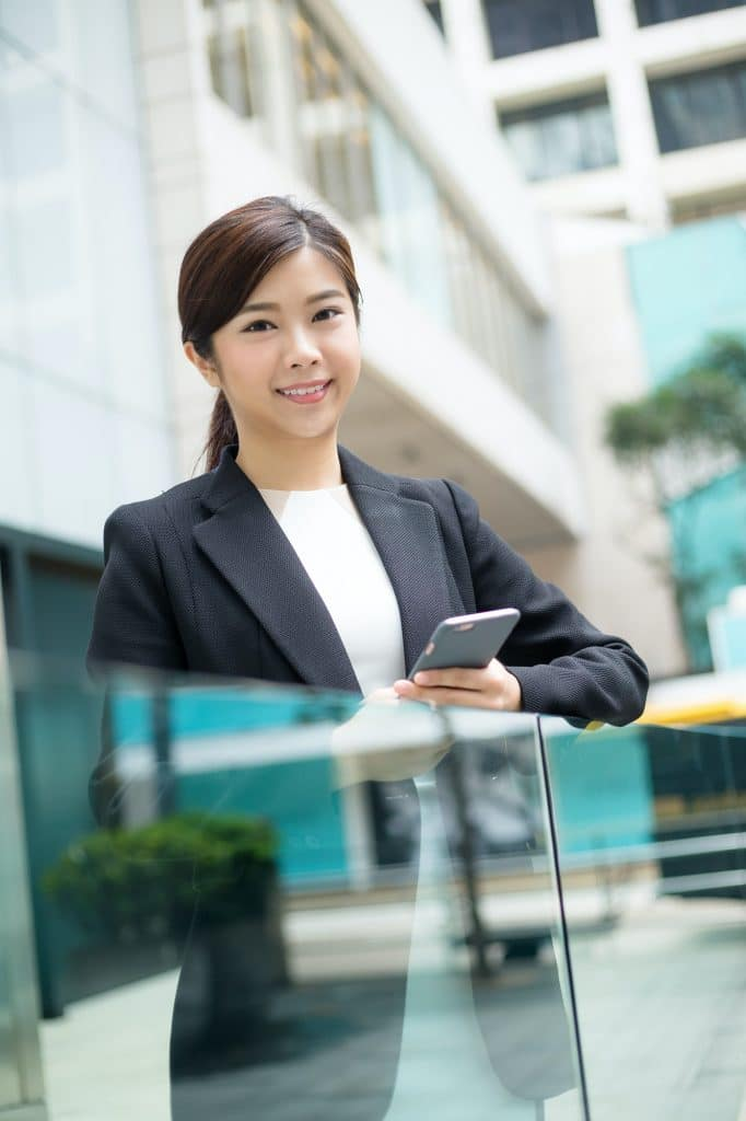 Businesswoman holding a phone
