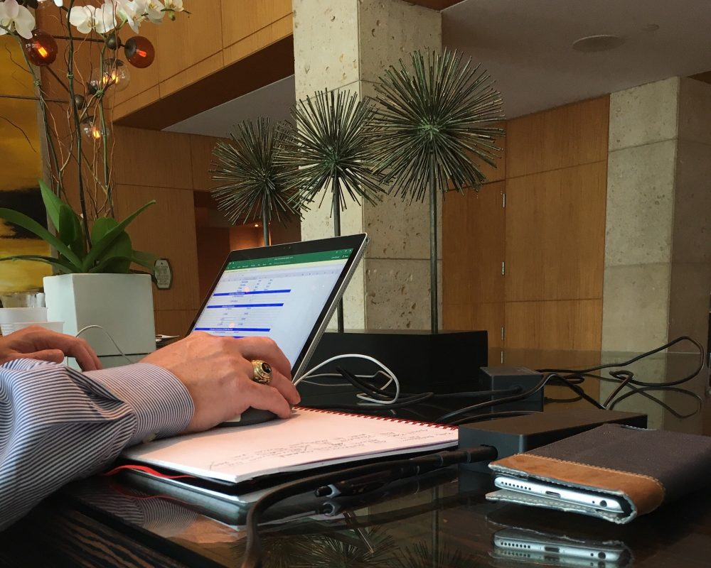Businessman on a laptop in a hotel lobby