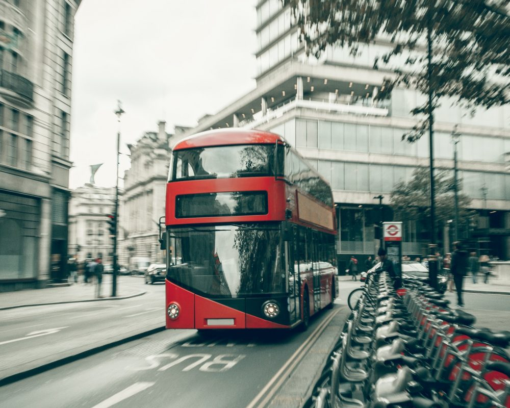 London red bus in motion.